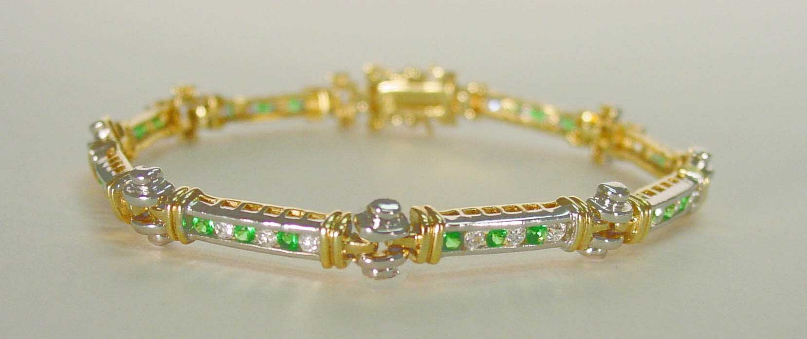 Emerald CZ & Clear CZ bracelet in channel setting