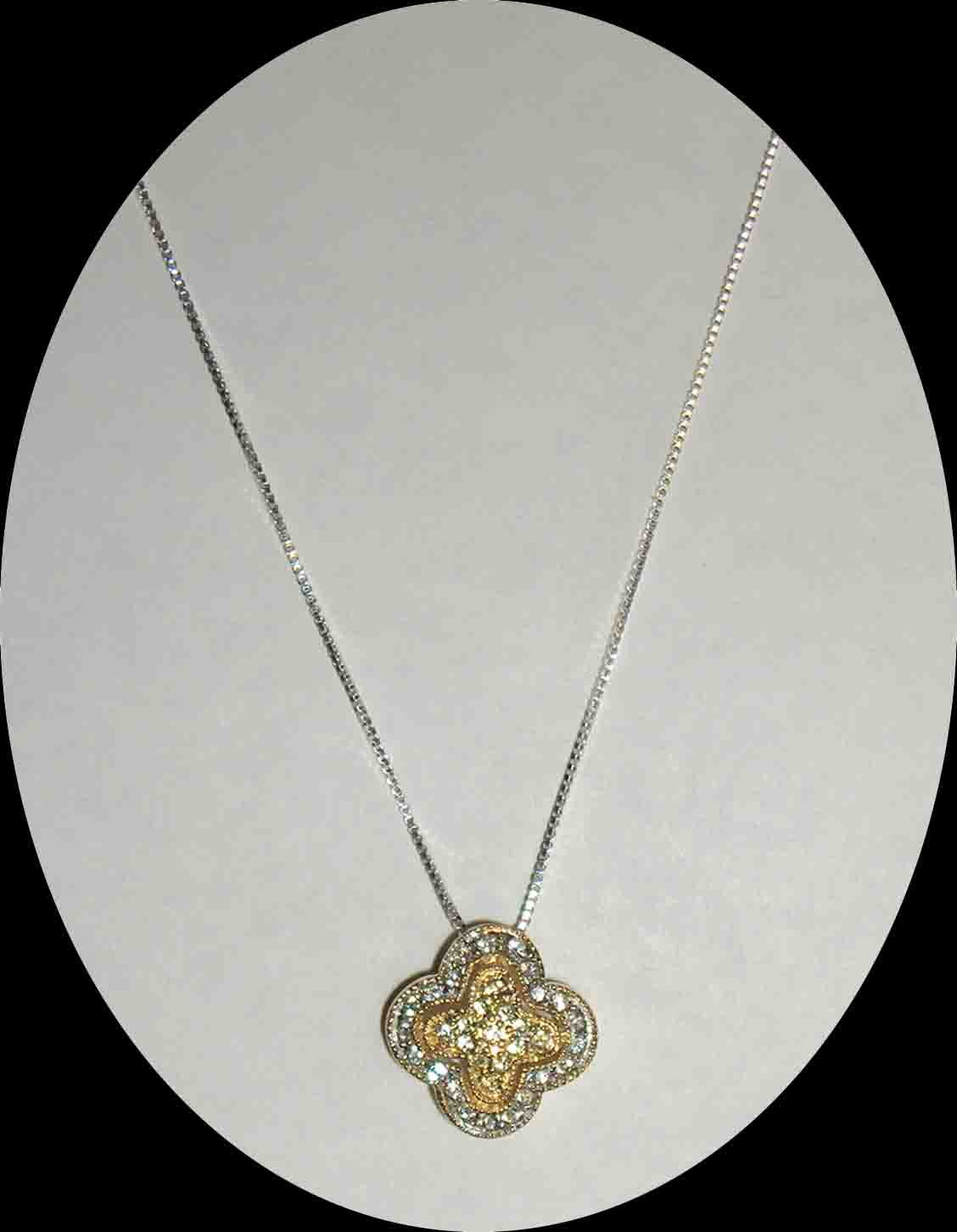 CZ encrusted yellow gold & silver pendant necklace